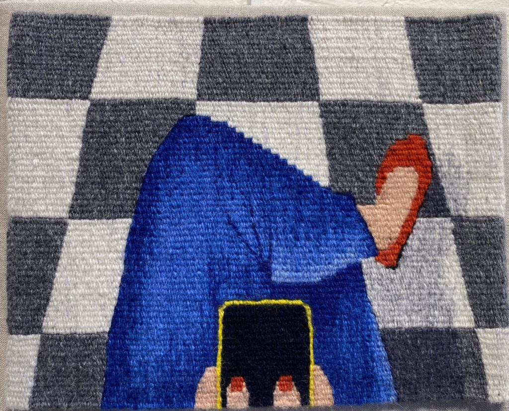 tapestry of woman in blue pants holding phone